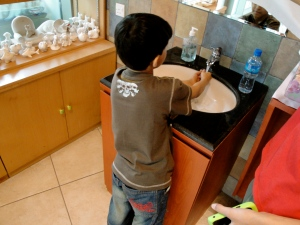 Essa Washing His Hands Before Coloring