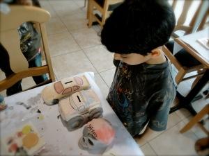 Ahmed Examining The Ceramics